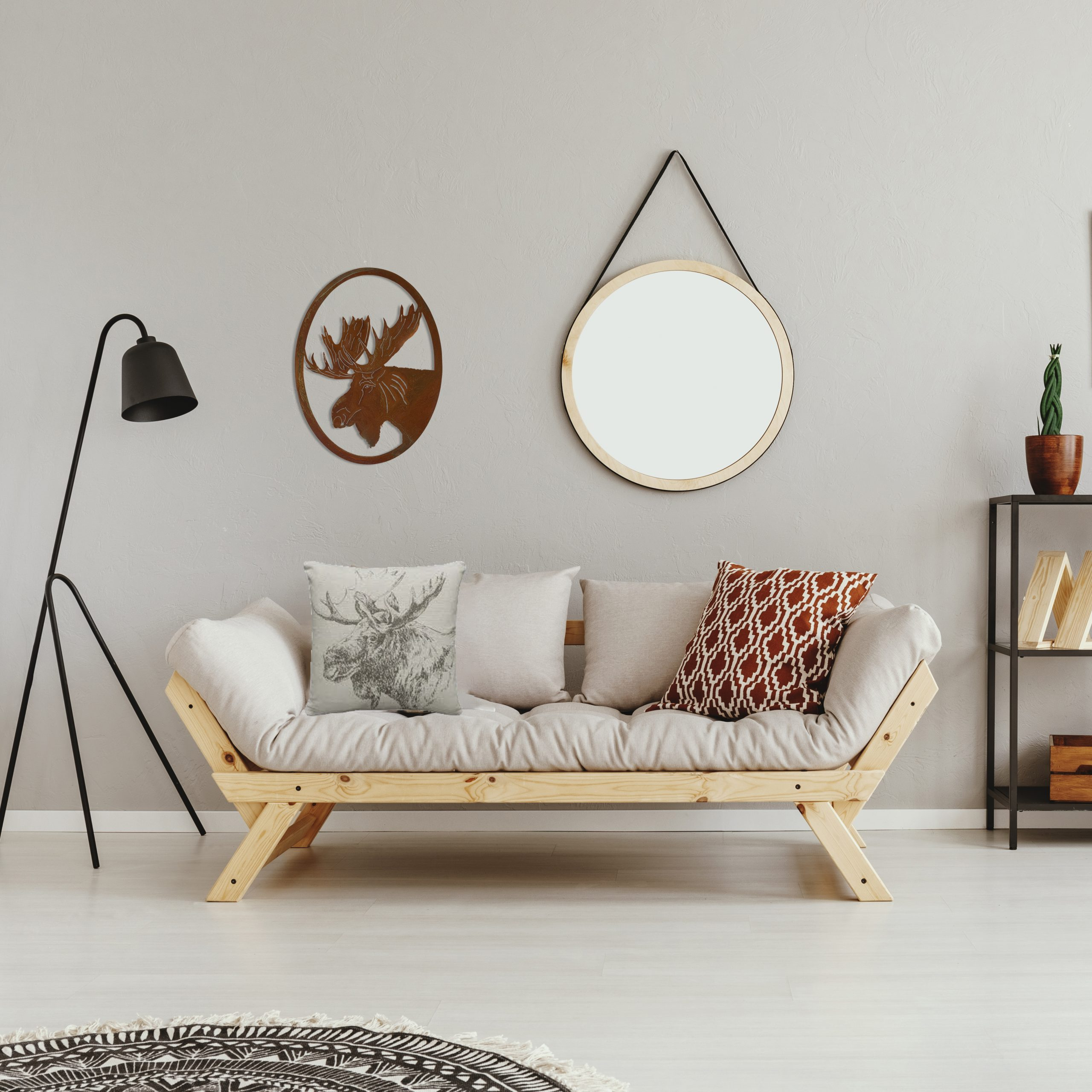 Moose-portrait-oval-rust-over-couch-scaled