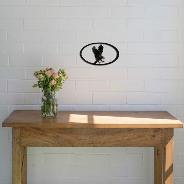 black-eagle-oval-over-table-scaled