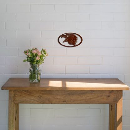 rust-eagle-head-oval-over-table-scaled