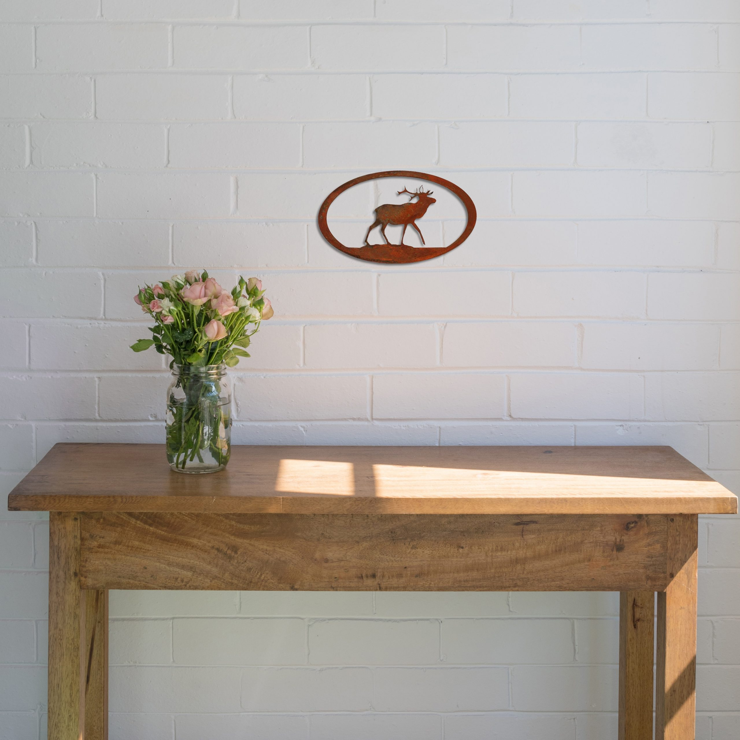 rust-elk-oval-over-table-scaled