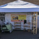 Outdoor display with canopy, signage, and shelving